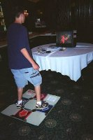 A guest tries his feet at Dance Dance Revolution.